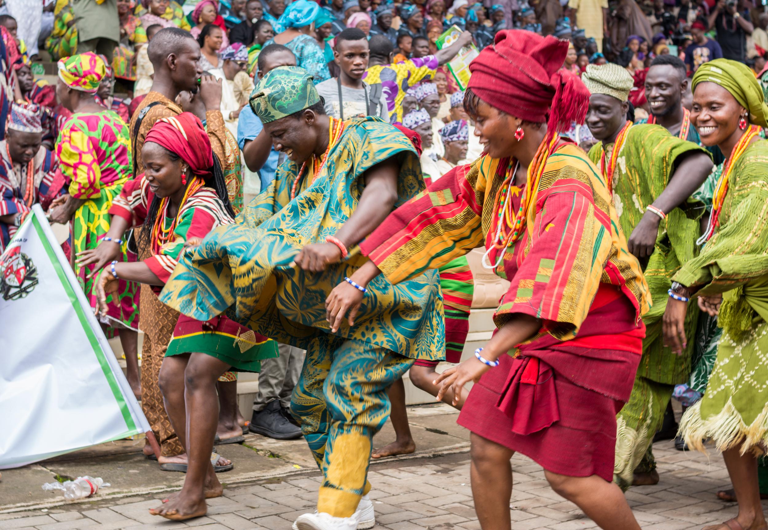 Members of a cultural troupe dances to entertain spectators during the Ojude Oba festival in Ijebu Ode, Ogun State.